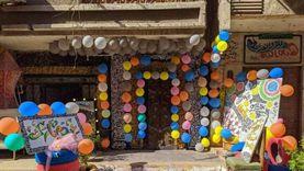 بالبلالين والرسم.. محمد يحول شارعهم إلى ديكور تصوير للاحتفال بالعيد