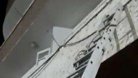 الحماية المدنية بقنا تنقذ قطة عالقة أعلى مبنى سكني (فيديو)
