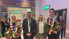 استقبال حافل من الشباب والرياضة لأبطال التايكوندو بمطار القاهرة (صور)