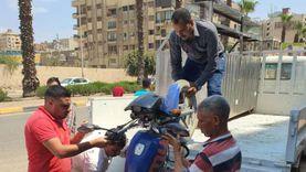 حمله لرفع الإشغالات وكلبشة السيارات المخالفة بالطالبية
