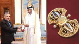 """""""وسام الوجبة"""".. أمير قطر يهدي 184 حجر ماس وياقوت لسفير إيران بالدوحة"""