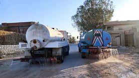 رش الشوارع بـ 5 مناطق سكنية بسيوة لمواجهة كورونا في العيد
