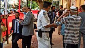 توزيع مياه وكمامات أمام لجان وسط القاهرة