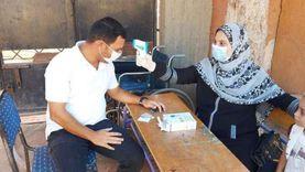 أطقم طبية لفحص حرارة الناخبين قبل التصويت بلجان المنيا