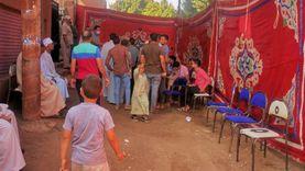 مظلات وكراسي متحركة لذوي الهمم أمام المقرات الانتخابية في بني سويف