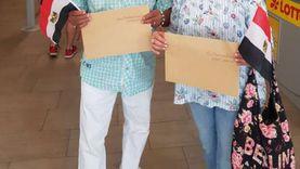 """أول عائلة مصرية بألمانيا تصوت في """"الشيوخ"""": هنفضل أسود زي ما السيسي طلب"""