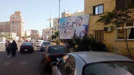 """مرشح لمنافسه بعد إزالة لافتته الوحيدة ببورسعيد: """"لي نعجة ولك 99 نعجة"""""""