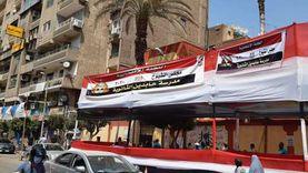 مواطنون يوزعون مياه وكمامات على الناخبين بوسط القاهرة