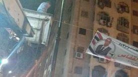 إزالة لافتات لدعاية انتخابية من الأعمدة الديكورية بدمنهور