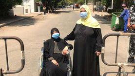 """""""مديحة"""" 69 عاما تشارك في الانتخابات على """"كرسي بعجل"""": صوتنا أمانة"""