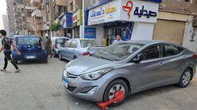 حملات لضبط السيارات المخالفة ورفع إشغالات المحال المقاهي بالجيزة