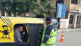 حملة مرورية مكبرة بمطروح للكشف عن التزام السائقين بارتداء الكمامة (صور)