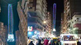 «مينا» يصنع أطول فانوس بالإسكندرية.. 23 مترا: «حبيت أعيد على اخواتي»