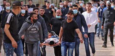 جرحى فلسطينيين فى اشتباكات القدس