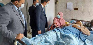 عدد من النواب خلال زيارتهم للمصابين