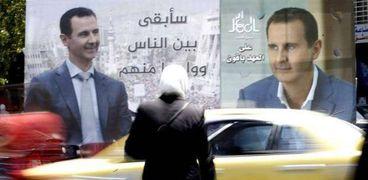 لافتة دعائية للرئيس الشوري والمرشح في الانتخابات بشار الأسد