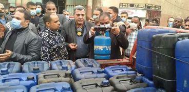 خلال الحملات لمصادرة محتويات ورش ومنشأة تستخدم المواد الخطرة بالجيزة