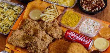 مطعم يقدم خصم 50% بمناسبة فوز الأهلي
