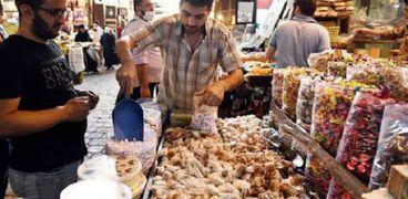 بيع الحلوى فى سوريا احتفالا بالأعياد ..صورة أرشيفية