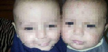 الطفلين التوأم.. ضحايا مذبحة كفر الدوار