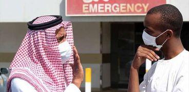 أمام إحدى المؤسسات بالمملكة العربية السعودية