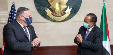 رئيس الحكومة السودانية ووزير الخارجية الأمريكى فى لقاء سابق