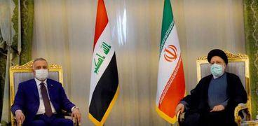 الرئيس الإيرانى ورئيس الوزراء العراقى خلال لقاء أمس