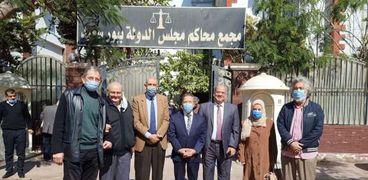 وفد الأطباء خلال حضور جلسة قضية التصالح في العيادات ببورسعيد