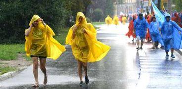 بالصور| تحت الأمطار.. المئات من الجزر البولينيزية يشاركون في افتتاح اليوم العالمي للشباب