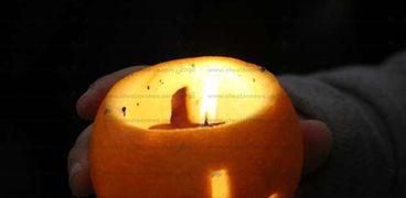 فانوس البرتقال.. طقس الأقباط في عيد الغطاس