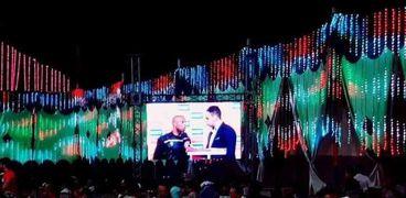 فرح السنبلاوين وشاشة عرض مباراة الأهلي والوداد