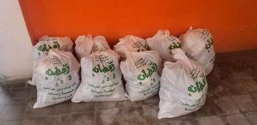 جانب من توزيع شنط رمضان