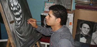 حسن ابو علي رسام بورترية