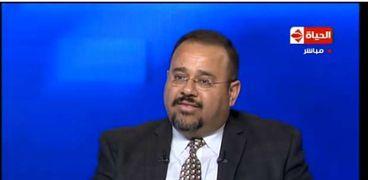 الدكتور هشام العسكري، الأستاذ بجامعة شابمن بالولايات المتحدة