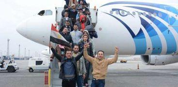 صورة أرشيفية لعاملين مصريين بعد عودتهم  لمصر بعد جائحة كورونا