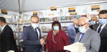 الدكتورة إيناس عبدالدايم وزيرة الثقافة ومحافظ بورسعيد خلال افتتاح معرض بورسعيد الرابع للكتاب