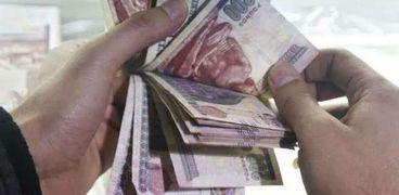 نقود( تعبيرية)