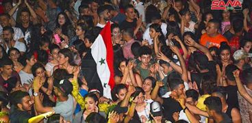 احتفالات السوريين بفوز بشار الأسد بانتخابات الرئاسة السورية 2021