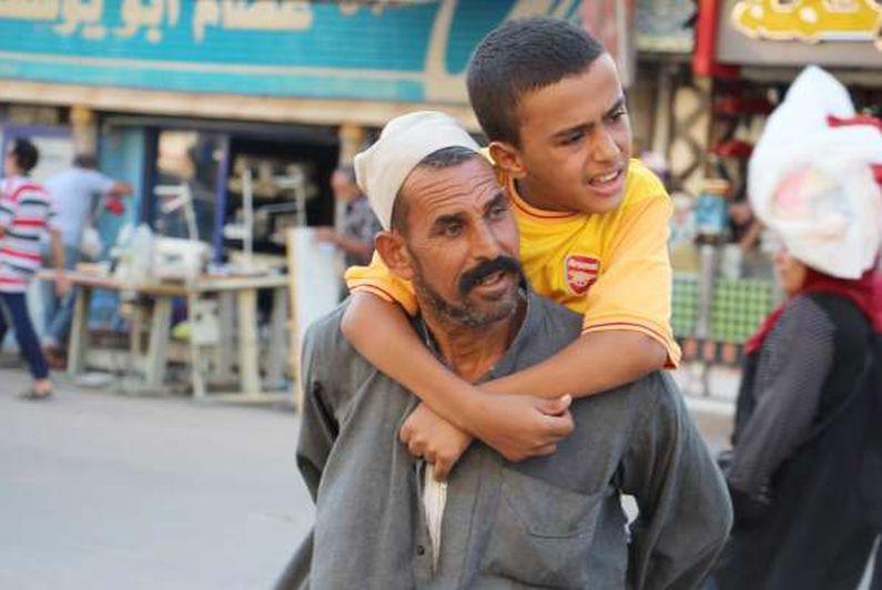 عم عطيه العربجي والد طفل مصاب بالضمور