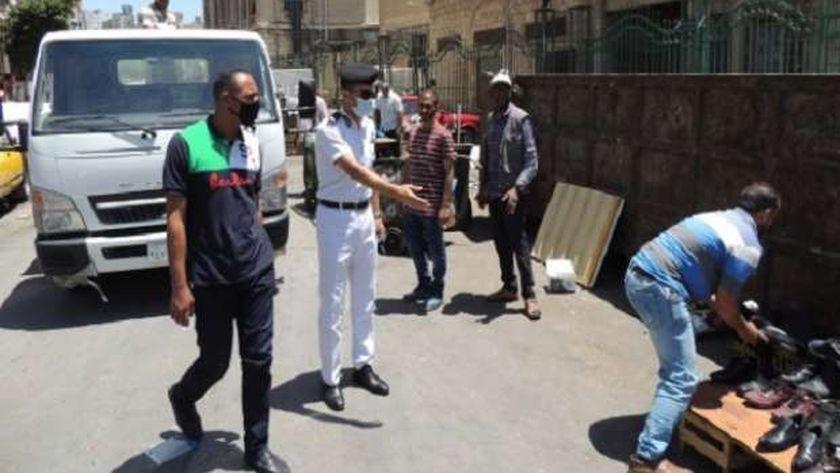 أمن الإسكندرية يشن حملات بمحيط ميدان محطة مصر لرفع الإشغالات