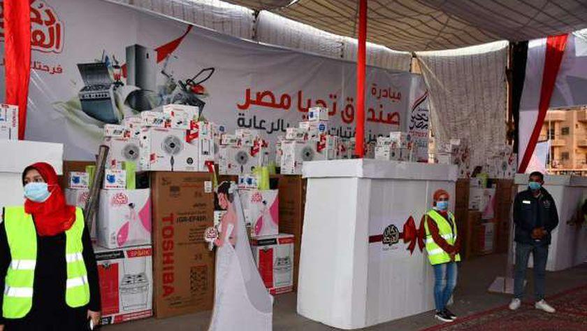 """تسليم 25 جهاز عروسة للفتيات اليتيمات ضمن مبادرة """"دكان الفرحة"""" بالفيوم"""