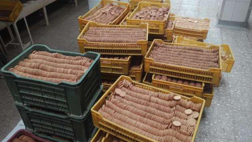 صورة ضبط مصنع ينتج «بسكويت شهير» منتهي الصلاحية في الجيزة – مصر