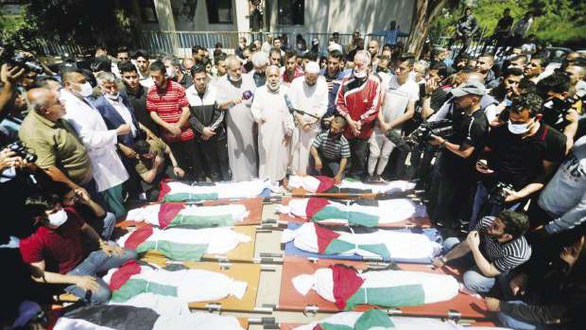 ضحايا العدوان الإسرائيلى على مخيم الشاطئ فى غزة