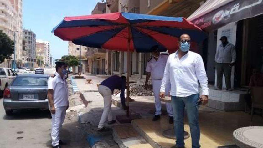 جانب من حملة مجلس مدينة مطروح على الشوارع للإشغالات والنظافة