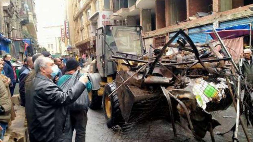 إزالة مخلفات حريق سوق التوفيقية