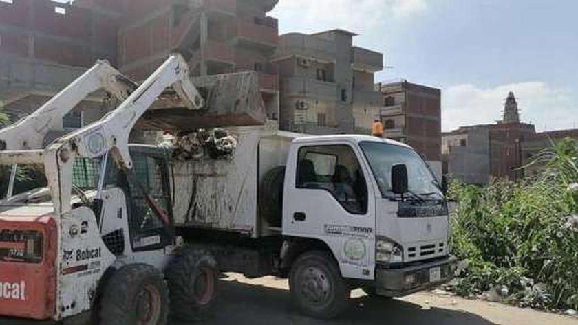 حملات نظافة مكثفة وصيانة أعمدة الإنارة بنطاق كفر الشيخ