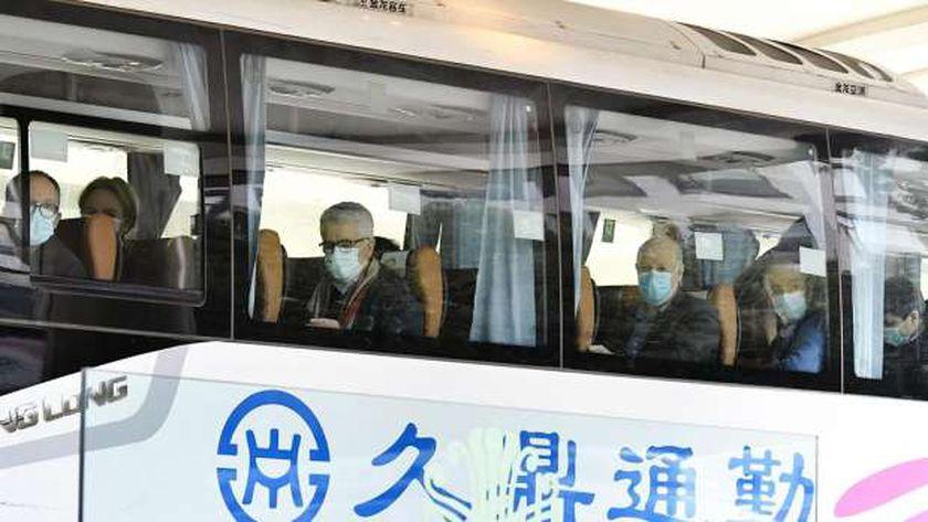 أعضاء فريق منظمة الصحة العالمية في الصين